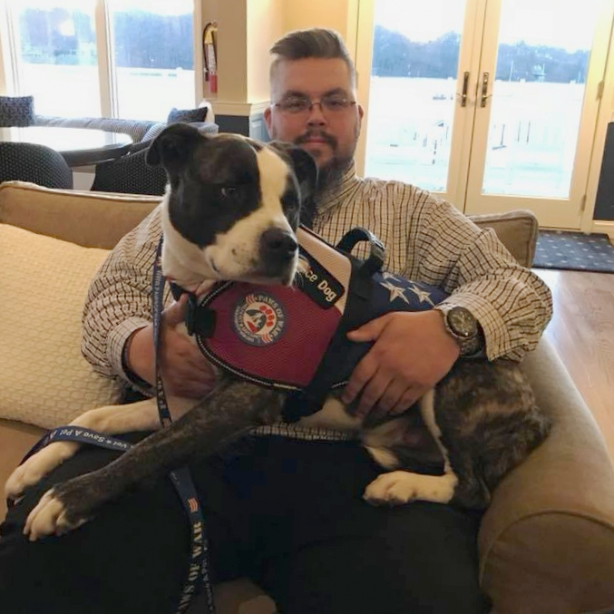 The Northport Yacht Club and Cow Harbor Warriors each raised $5,000 to help unite Army veteran William Wurm with his new service dog Shadow, 6-year-old brindle and white pit mix.