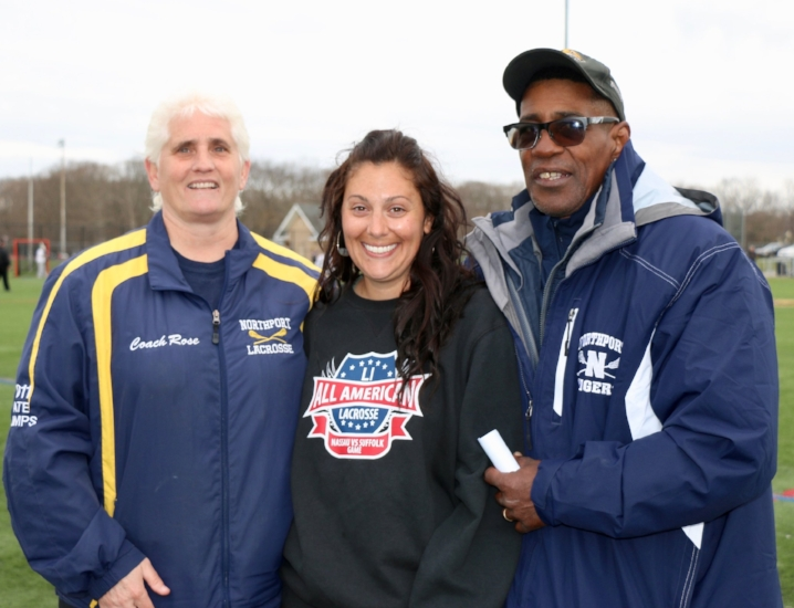 Northport High School girls lacrosse coach Carol Rose, left, with her husband Al, right, and her assistance Alexis Curcio, center, celebrates her 400th career win on April 24.   (Photo/Northport-East Northport schools)