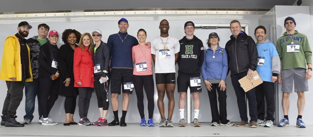 Town councilmembers Joan Cergol and Mark Cuthbertson stand with participants of the 5K Run to Save Lives.   (Photos/Town of Huntington)