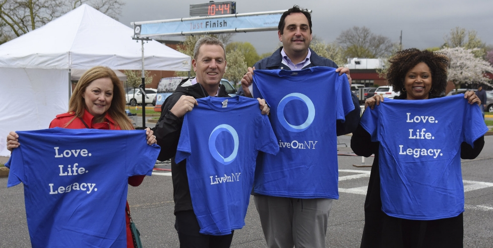 Town councilmembers Joan Cergol and Mark Cuthbertson, left, are joined Sunday at their 5K Run to Save Lives by Town Supervisor Chad Lupinacci, right-center, and Tax Receiver Jillian Guthman.