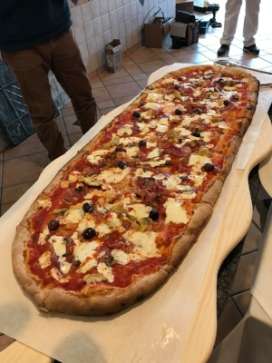 The meter-long Quattro Stagioni pie ($44), which is topped with fior di latte, prosciutto, artichokes, black olives and mushrooms.   (  Photo/Facebook/Il Vecchio Forno