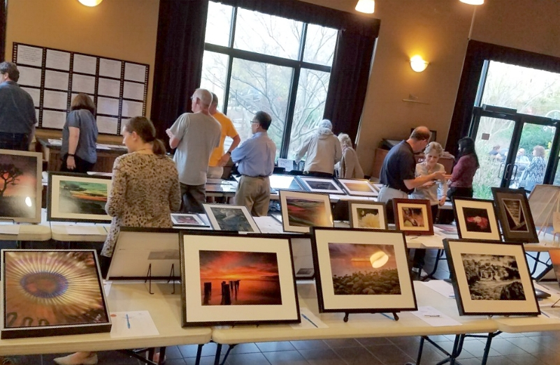 The Huntington Camera Club hosted the auction at the Cinema Arts Centre in Huntington.  (Photo/Harry L Schuessler)