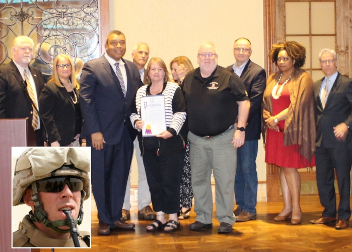 "Members of the family of Marine Cpl. Christopher Scherer of Northport (inset photo) receive a proclamation at the Veteran's Appreciation Breakfast. At the presentation, from left, are: Director of Suffolk County Veterans Service Agency Tom Ronayne, Legislator Susan Berland, Legislator William ""Doc""  Spencer, Huntington Highway Superintendent Kevin Orelli, Scherer's parents Janet and Timothy, Legislator Robert Trotta, Huntington Tax Receiver Jillian Guthman, and Legislator Steven Flotteran."