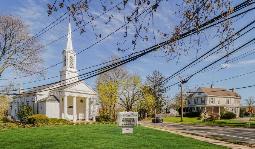 The First Church of Christ Scientist building and property at the corner of Main Street and Nathan Hale Drive is on the market for $2.2 million.  (Photo courtesy Signature Premiere Properties