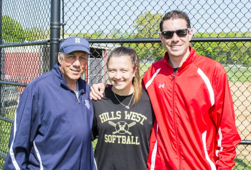 Half Hollow Hill High School West senior Jillian Weinstein, center, celebrates Monday receiving the Township of Huntington Softball Hall of Fame's 2018 Girls Softball Scholarship with committee chairman Jim Byrnes and her coach Bryan Dugan.   (Long Islander News photo/Connor Beach)