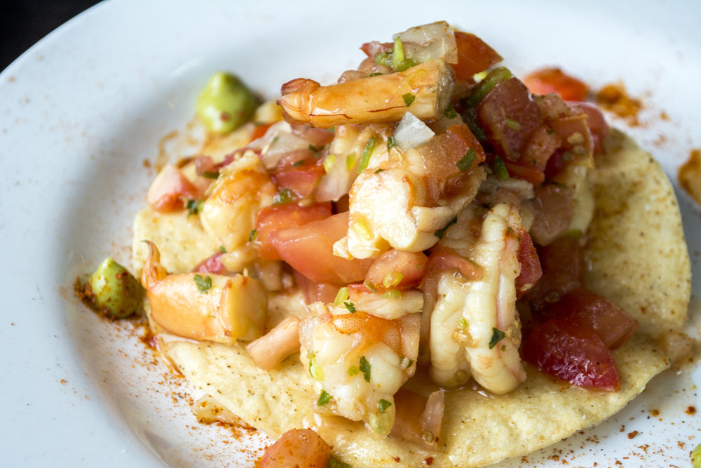 Shrimp Ceviche Tostada ($14) features shrimp, tomato, lime and jalapeno over a crisp tortilla.