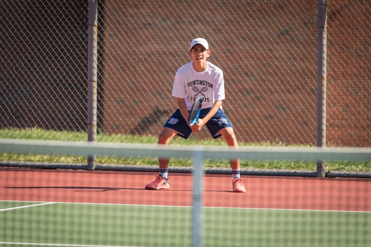 Huntington sophomore Jack Flores in action for the Blue Devils tennis team.  (   Photo/Darin Reed)