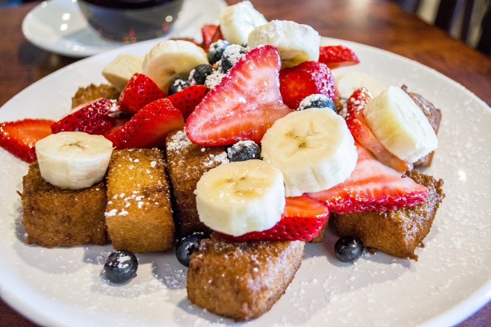 French Toast Bites ($9.99) are topped with fresh berries, bananas, strawberries and powdered sugar.