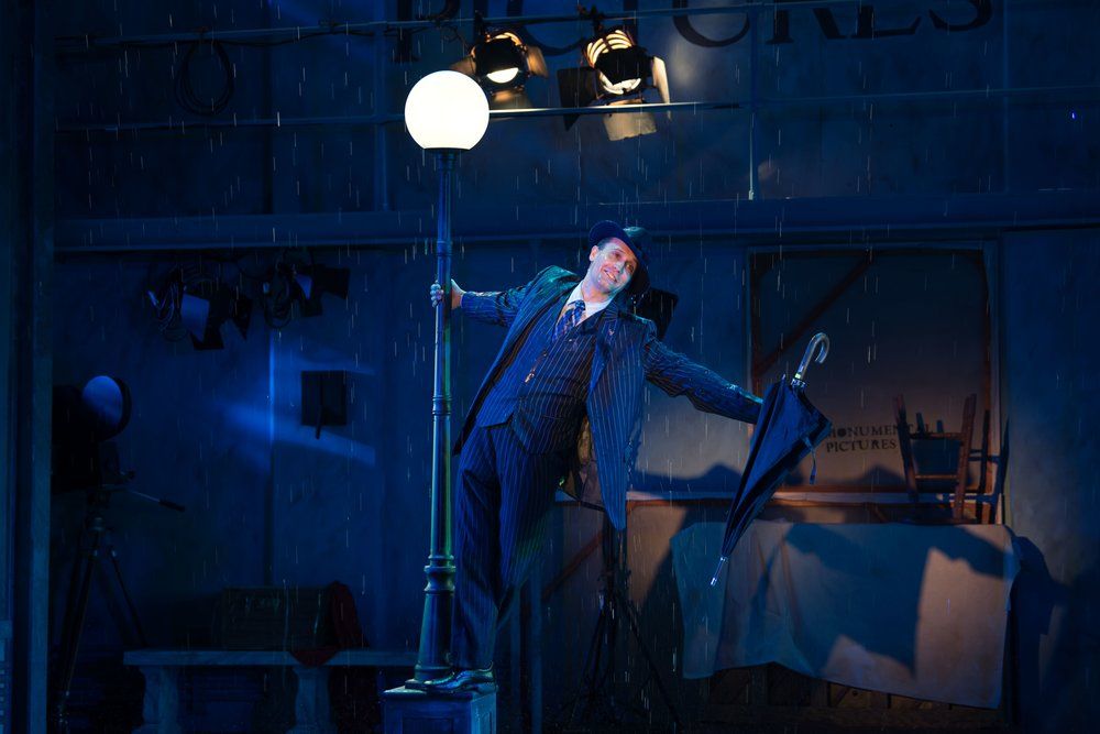 "Danny Gardner dazzles audience members portraying the lovestruck Don Lockwood in the iconic scene from ""Singin' in the Rain.""   (Photos/Michael DeCristofaro)"