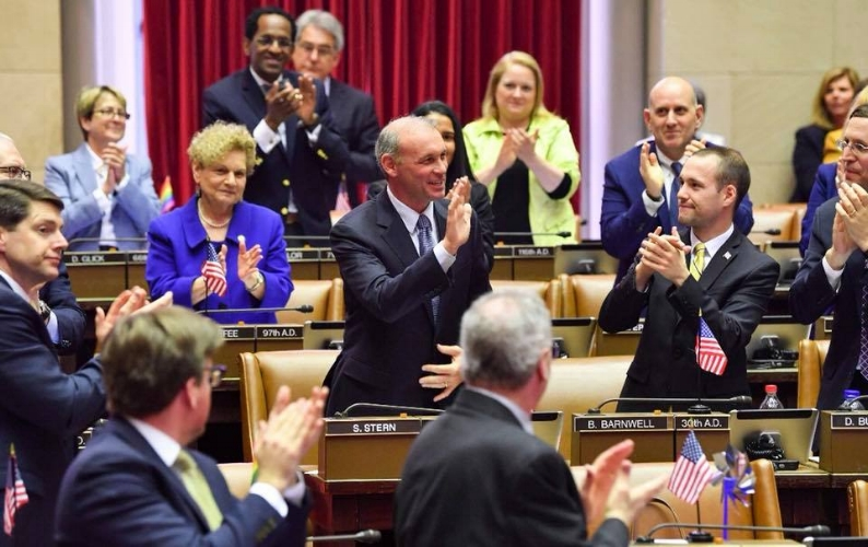 Freshman State Assemblyman Steve Stern, center, is welcomed to the legislature by his fellow lawmakers earlier this month.   (Photo/Facebook Steve Stern)