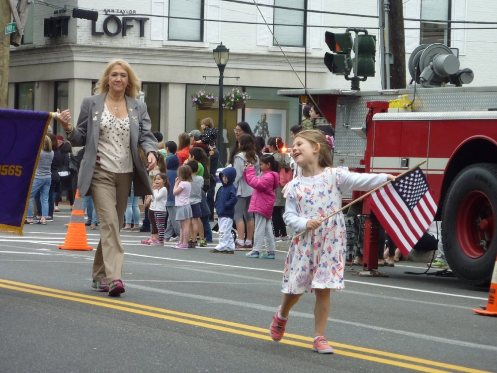 Ava Rosalie Busche had a grand time marching in Huntington's Memorial Day Parade Monday. The great granddaughter of Elks officer Judith Warden of East Northport, she led the Elks Post 1565 contingent in the march on Main Street.   (Long Islander News photos/Peter Sloggatt)