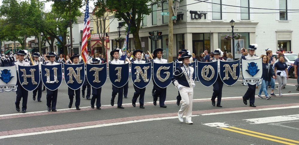 Huntington High School's Blue Devil Marching Band played patriotic tunes on the march through Huntington Village.