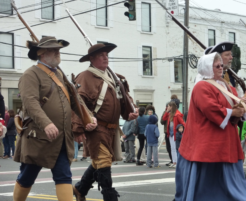 Members of the Huntington Militia recalling Colonial-era Huntington with authenic dress and gear, including muskets.