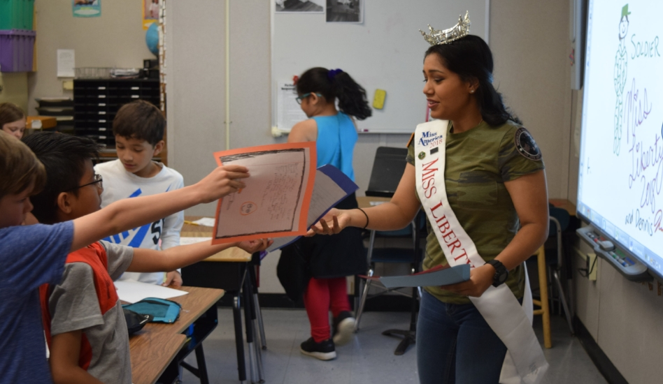 Inpreet Rattu used her position as Miss Liberty to inspire students at Birchwood Intermediate School in Huntington Station to write letters thanking military service members and first responders for their service.   (Photos courtesy of Inpreet Rattu)