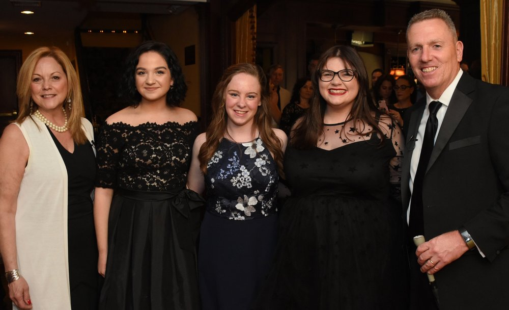 "Hosts of the 2018 Hunting-Tonys, Councilman Mark Cuthbertson, far right, and Councilwoman Joan Cergol, far left, with, from left: Isabella Donneruno, Meaghan Maher and Sara Meade, each of whom performed in Northport High School's production of ""The Music Man.""   (Photos by Douglas Martines)"