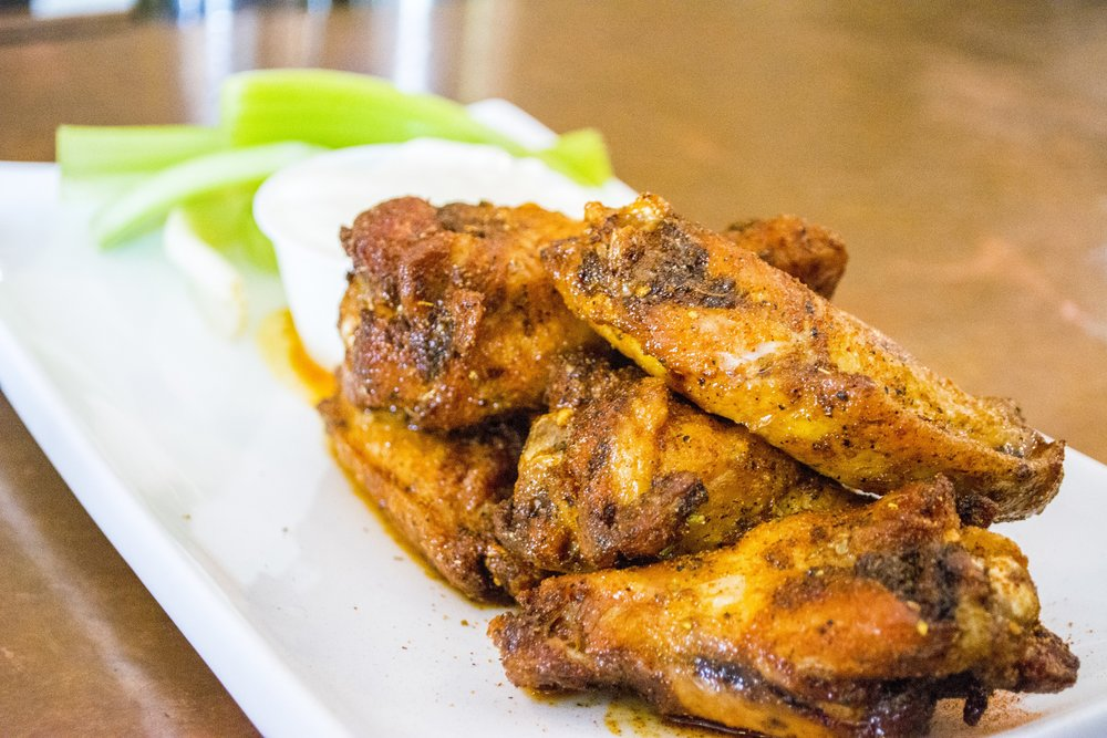 Cajun Wings ($8 for six) are dry rubbed with seasoning that adds a depth of unique flavors.