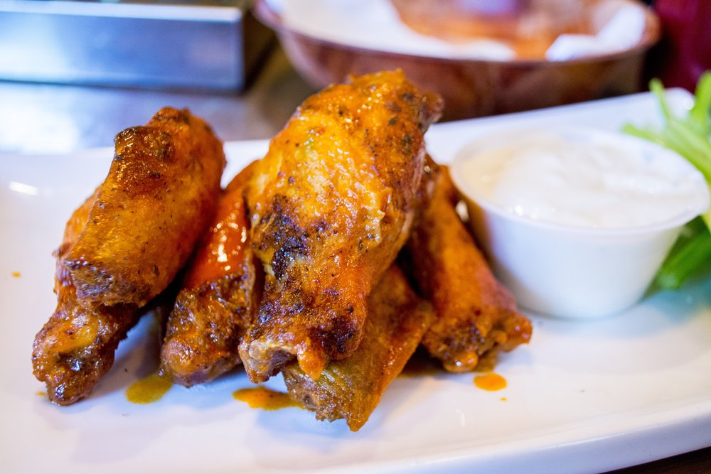Buffalo Wings ($8 for six), ordered medium, pack a moderate level of spice that didn't overpower the taste of the well-seasoned chicken.