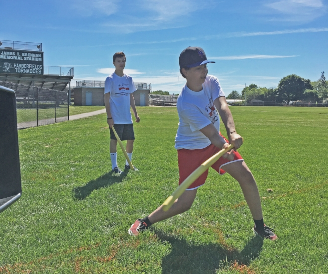 The annual Father's Day Charity Wiffle Ball Tournament in Greenlawn raised $9,300 toward local outreach efforts and college scholarships.   (Photos courtesy of Philip De Dora)