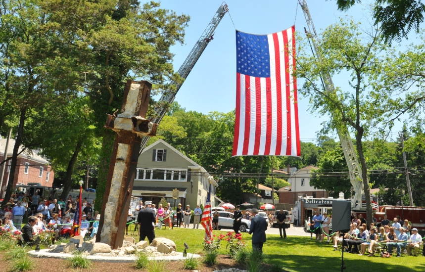 Firefighters, community members and elected officials gather in the Cold Spring Harbor Fireman's Park Saturday afternoon to dedicate a 9/11 memorial that included one of the last remaining pieces of steel from the World Trade Center.  (Photo/Steve Silverman)