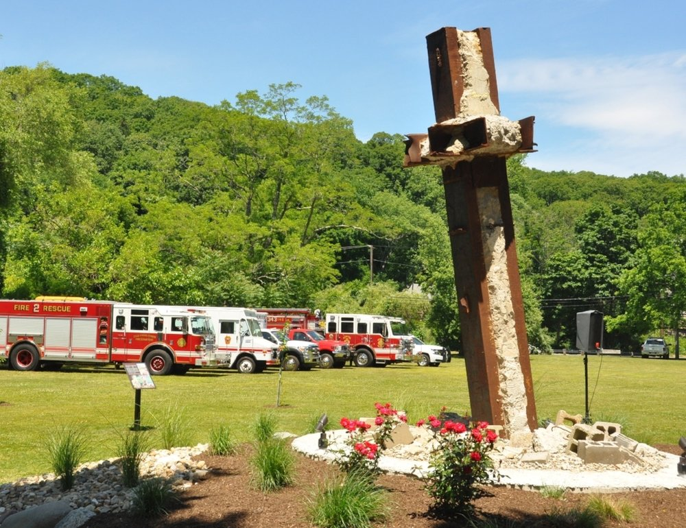 A 18,000 pound steel beam from tower one of the World Trade Center dominates the 9/11 memorial in Cold Spring Harbor.   (Photos/Steve Silverman)
