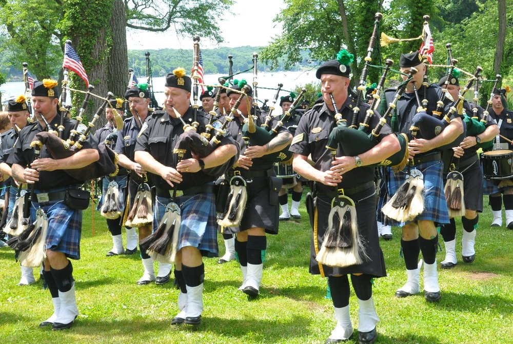 The Port Authority Police Pipe Band led the procession of firefighters during Saturday's 9/11 memorial dedication in Cold Spring Harbor.