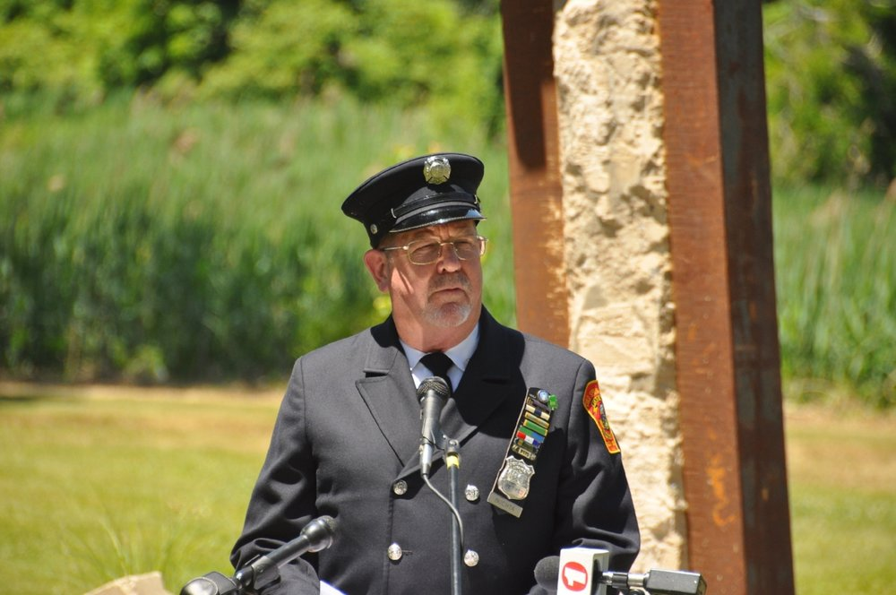 Memorial committee chairman and retired Port Authority police officer Thomas Buchta speaks at the ceremony.