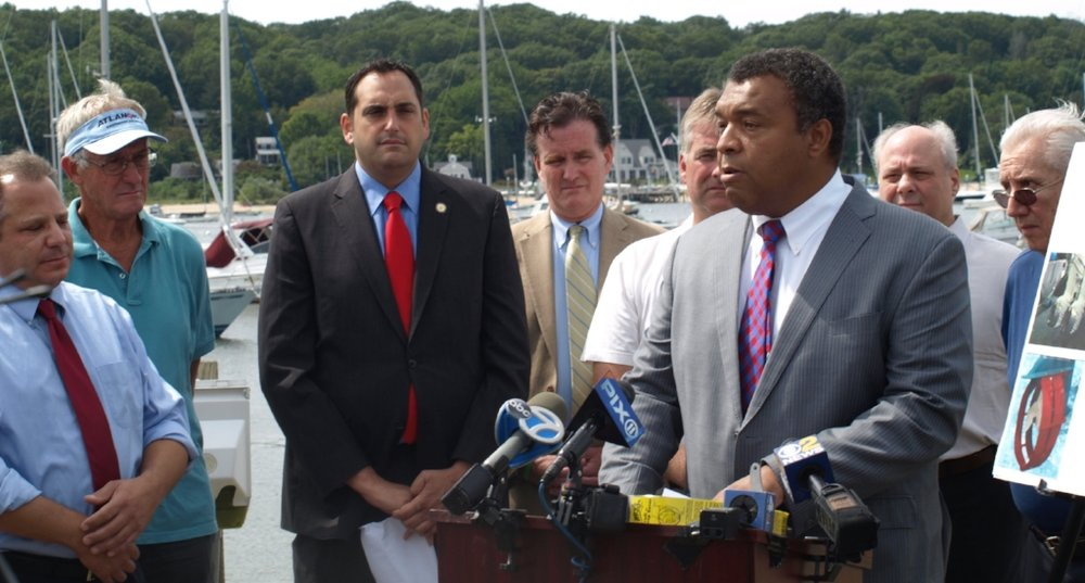 """Suffolk Legislator William Spencer (D-Centerport), right, is pictured at a press conference last August at which he first announced plans to enact his """"Ryan's Law,"""" which was approved Tuesday, and will require propeller guards be installed on all instructional vessels that operate in Suffolk's waterways.   (Long Islander News photo/archives)"""