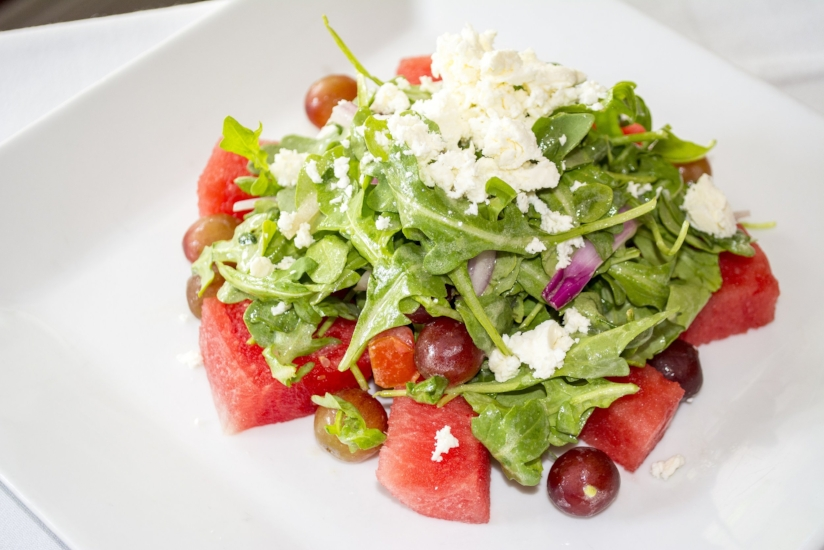 Watermelon Salad ($13) features watermelon, baby arugula, grapes, red onion, feta cheese and citrus vinaigrette.