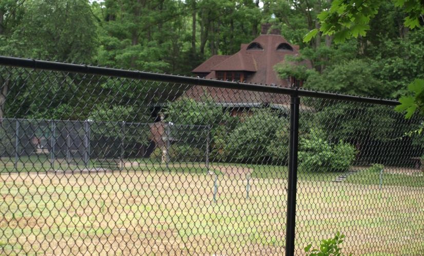 A developer plans to construct a 64-bed assisted living facility on this site at the corner of Woodbury Road and East Gate Drive in Cold Spring Harbor, where there's currently an unused tennis club.   (Long Islander News photo/Connor)