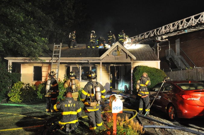 A total of 60 firefighters battled the blaze in the East 23rd Street home Tuesday night.   (Photo/Steve Silverman)