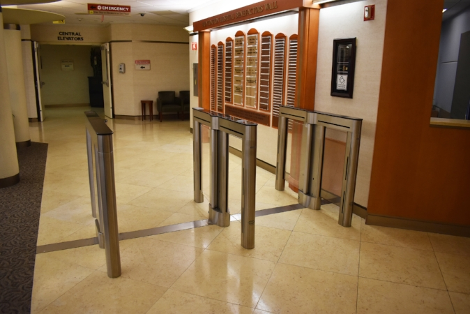 New security turnstiles at Huntington Hospital prevent visitors from entering the building without first getting a temporary identification badge.   (Photo/Huntington Hospital)