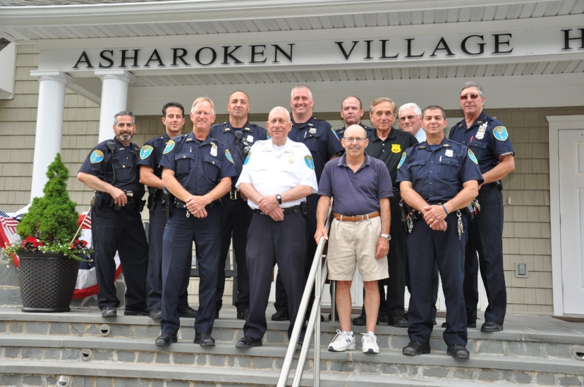 Asharoken Village Officials and Asharoken Police are pictured at Village Hall following a briefing on July 4 in preparation for the annual fireworks show. Asharoken Police provided additional patrols to assist with traffic control, and ensure the safety of residents and visitors during the event. Pictured, front row, from left, are: Officer Jeff Josephson, Officer-in-Charge Ray Mahdesian, Asharoken Mayor Greg Letica and Officer Tony Canino. Top row: Officers Alex Rubino, Steve Demarco, Joey D'Alessandro, Brian O'Connor, Mitch Bank, Police Commissioner and Trustee Mel Ettinger, and officers Sid Lynn and Jim Cox.   (Photo/Steve Silverman)