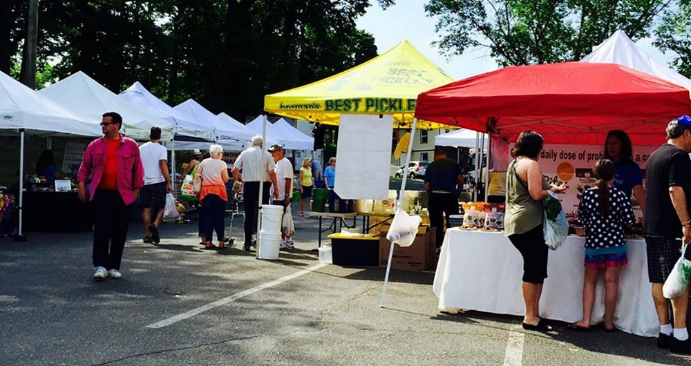 Business at the Huntington Farmers Market, which pops up 7 a.m.-12 noon each Sunday in the village, was disrupted this year when public safety officials launched a crackdown on sampling.   (Photo/Facebook/Huntington Farmer's Market)