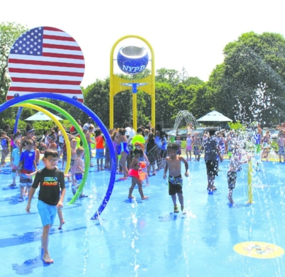 Children splash their way through Huntington's first spray park on Wednesday.   (Long Islander News photos/Tatiana Belanich)