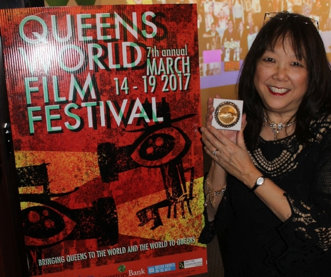 """Patricia Shih accepts an award at The Queens World Film Festival for her debut film, """"Undocumented.""""   (Images courtesy of Patricia Shih)"""