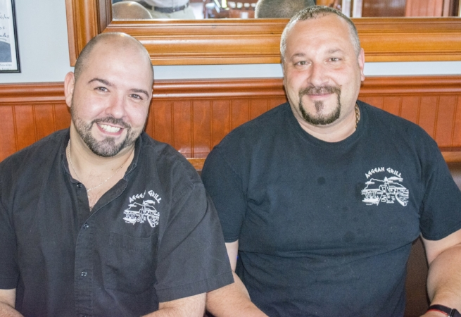Aegean Grill owner Alex Stathatos, right, and manager Anthony Dokas work together to provide customers great food and a welcoming atmosphere.   (Long Islander News photo/Connor Beach)