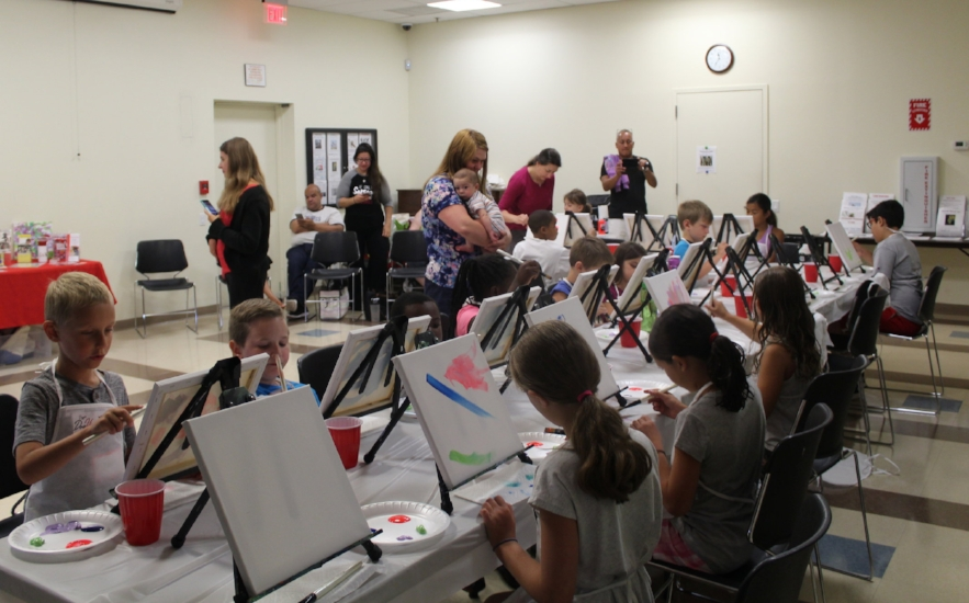Attendees of Saturday's program make their own abstract masterpieces.