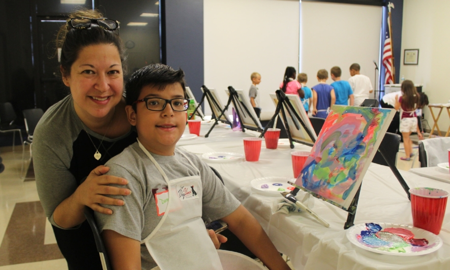 Michelle Laredo-Torres with son Damian, 9, and his creation