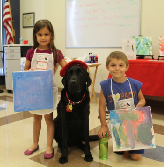 Siblings Emma, 5, and Thomas Pandolfi, 7, show of their paintings with DogVinci.