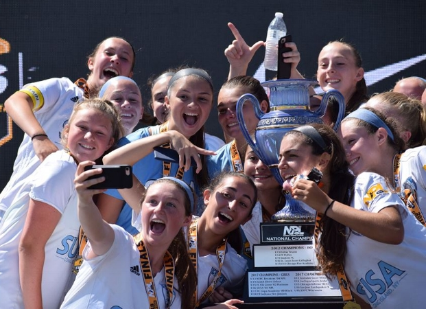 Players from the SUSA FC girls NPL 2003 club soccer team celebrate with the trophy after winning the National Premier League 2003 division national championship last week.   (Photo/Facebook/US Club Soccer)