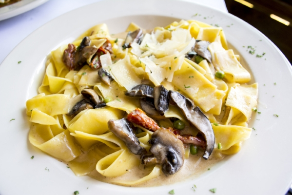 Papadella Salese ($20/$26) features wild mushrooms, prosciutto, sundried tomato, peas and truffle cream sauce.