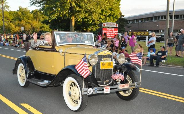 Huntington Town Clerk Jo-Ann Raia rides in an antique car.