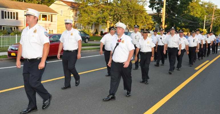 Members of the Huntington Fire Department led by Chief Robert Conroy.