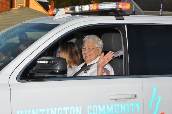 Andrea Golinsky, ex-chief of the Huntington Community First Aid Squad, waves to the crowd.