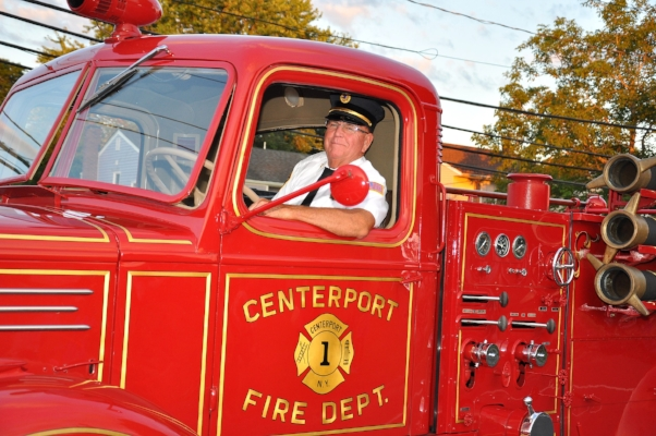 Centerport ex-Chief Jim Feeley at the wheel of the department's antique truck.