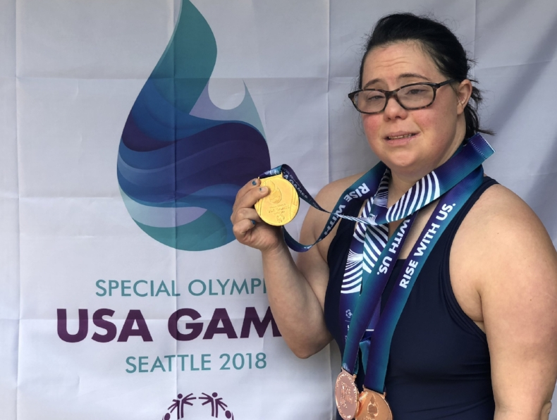 Swimmer Danielle Birnbaum shows off the gold medal she won at the Special Olympics in Seattle.  Photo by Laura Birnbaum