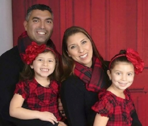 Christopher Raguso with his wife, Carmela, and two young daughters.