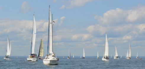 A fleet of 43 sailboats sail the waters off Huntington to provide therapeutic relief to veterans and their families.