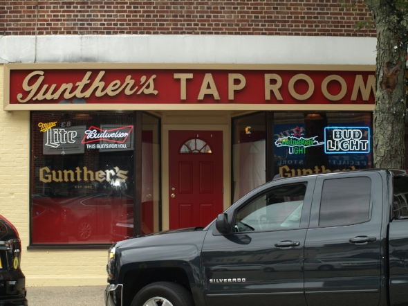 Boards were off the windows of Gunther's Tap Room last week after a fire forced the owners to close for over a year. The iconic bar on Northport's Main Street reopened Thursday.   Long Islander News photo/Pat Mellon