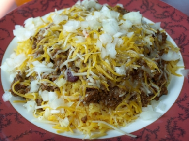 Tex-Mex ground beef served over rice with cheese and onion ($9.90) is one of Faz's specials.  Long Islander News photos/Connor Beach